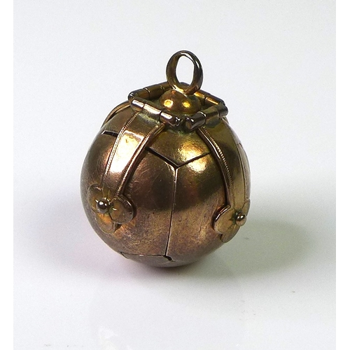 221 - A Masonic orb pendant, the exterior and hinged clasps covered in 9ct gold, opening into a cross form...