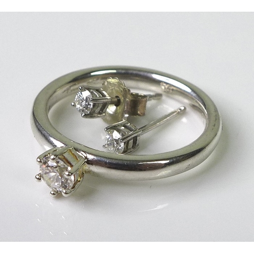 209 - A pair of diamond stud earrings, approx 0.15ct total diamond weight, set in 9ct white gold, missing ...