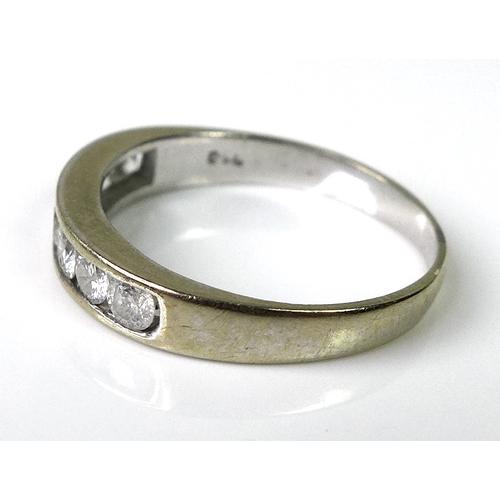 224 - An 18ct white gold half eternity diamond ring, set with seven diamonds, approx 0.5ct total diamond w...
