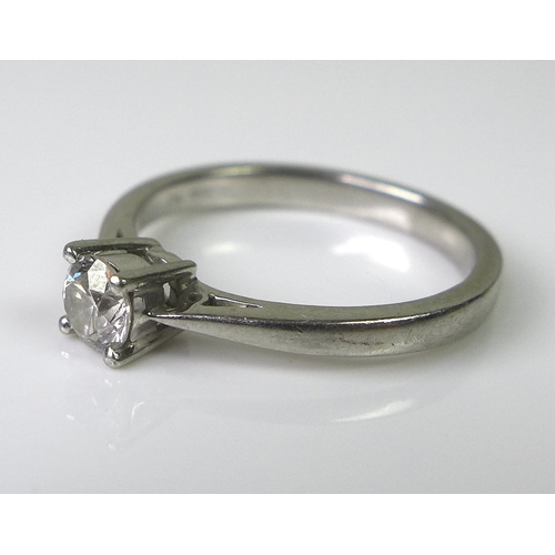 222 - A platinum and diamond solitaire ring, the diamond approx 0.25ct, size K 1/2, 3.7g.