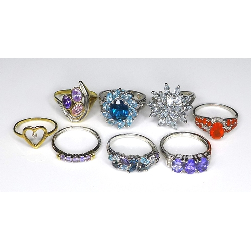 121 - A group of 9ct gold rings, comprising six white gold dress rings set with coloured stones, and two y...