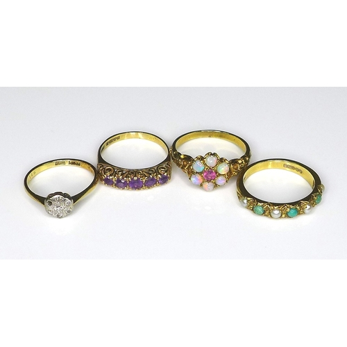 102 - A group of four Victorian/Edwardian 9ct gold rings, comprising a flowerhead ring set with six opals ...