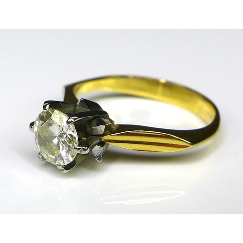 252 - An 18ct gold and diamond solitaire ring of modernist form, white metal starburst setting with cutawa...