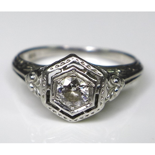 211 - An 18ct white gold and diamond Art Deco style solitaire ring, the 0.25ct diamond within a hexagonal ...