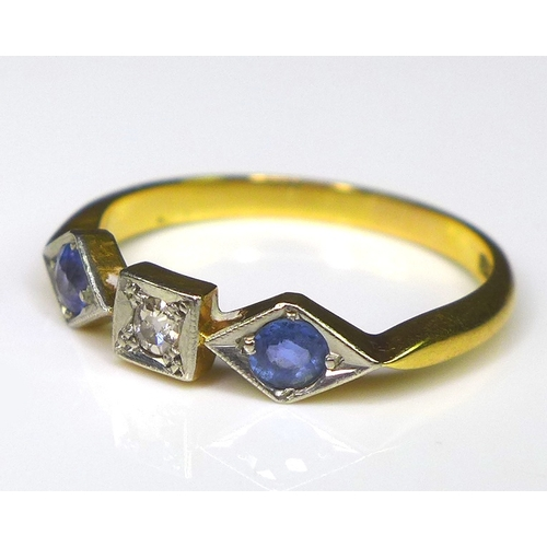 213 - An 18ct gold and diamond three stone ring, in an abstract setting, the stones of graduating size and...
