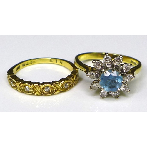 101 - An 18ct gold, diamond and aquamarine ring, the central round cut aquamarine of 6mm diameter and surr...