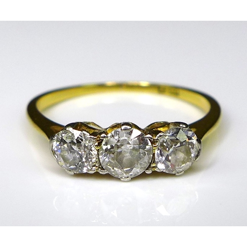249 - An 18ct gold and diamond three stone ring, the central diamond of 0.3ct and the two flanking it each...