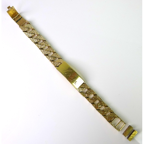 251 - A 9ct gold identity bracelet, bark texturing to curb links, central plaque engraved, plaque and link...