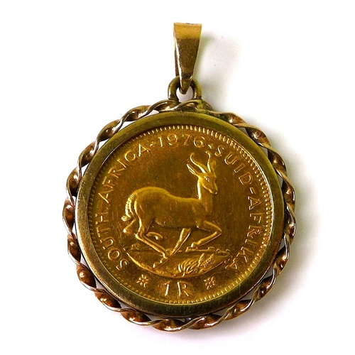 90 - A South African gold 1 Rand coin, 1976, in 9ct gold pendant mount, 5.7g total....