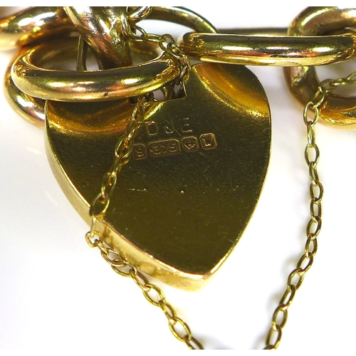 244 - A 9ct gold curb link bracelet with padlock clasp, marked to clasp and each link, 20cm long, 43.4g....