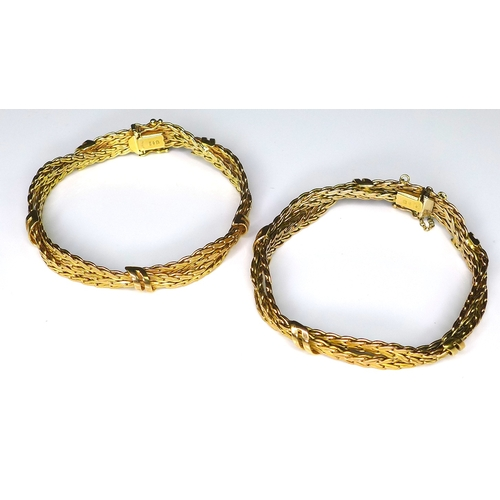246 - A pair of 9ct gold bracelets of woven banded form, each approximately 6.5cm diameter, 51g total. (2)...