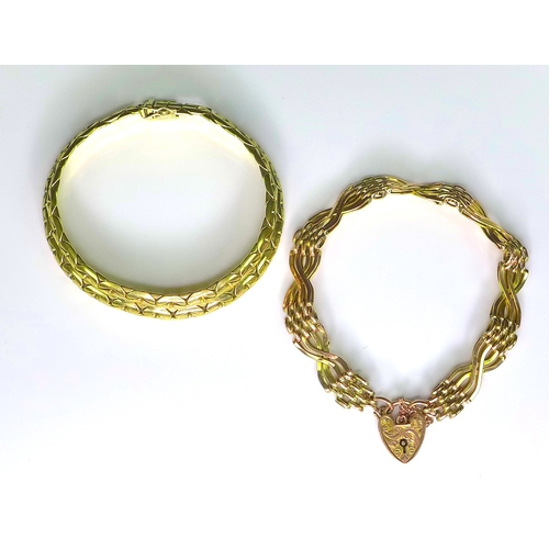 225 - Two 9ct gold bracelets, one fancy link, approximately 6.8cm diameter, the other with a heart padlock...