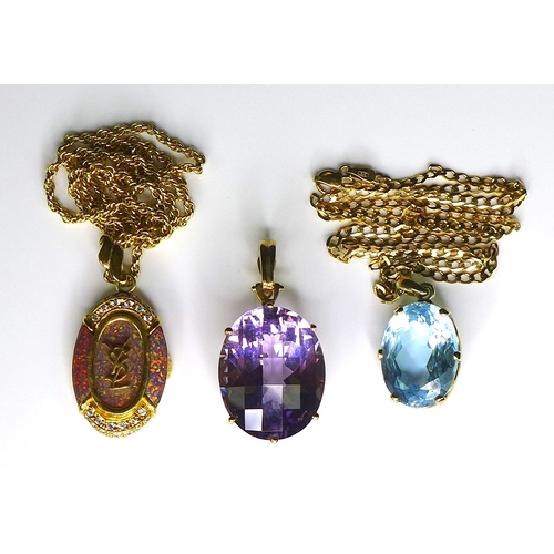 202 - A group of three 9ct gold pendants, comprising one set with a large lilac stone, the second set with...
