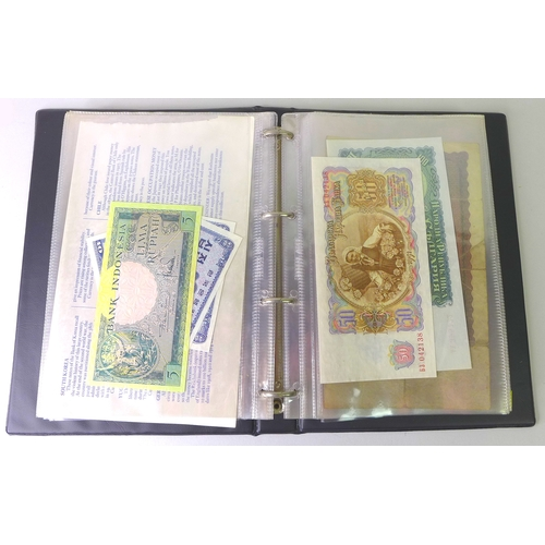 85 - A collection of mostly early to mid 20th century world bank notes, including notes from Shanghai, Ch...