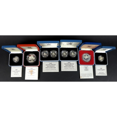 94 - A group of cased silver proof coins, comprising 1996 crown commemorating Her Majesty Queen Elizabeth...