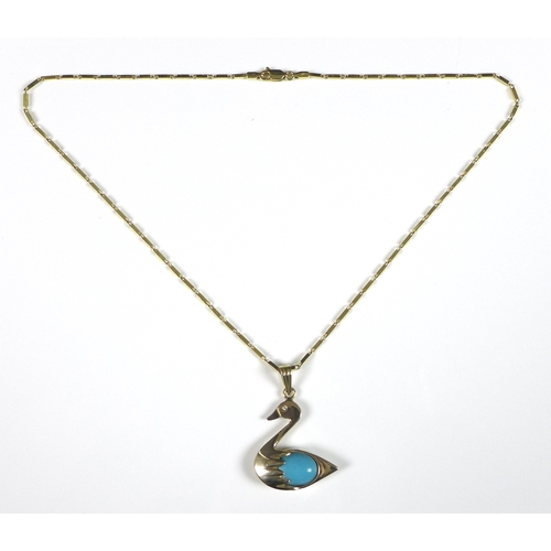 135 - A 14k gold pendant and necklace, in the form of a swan with turquoise body and diamond chip eye, 3 b...
