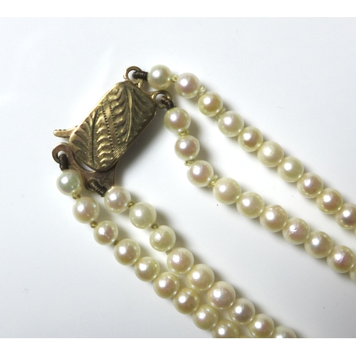 136 - A double strand of Mikimoto cultured pearls, on 9ct gold engraved clasp, the pearls graduated from 7...