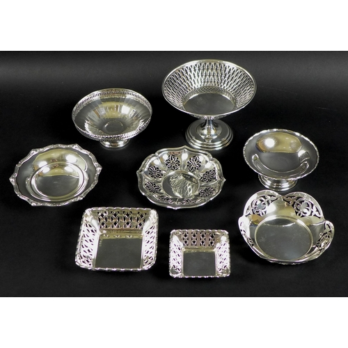 44 - A collection of silver, including a silver collared decanter, the glass body and matching stopper fo...