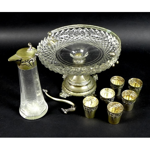 24 - An early 20th century Continental silver liqueur decanter with six matching silver cups, all chased ...