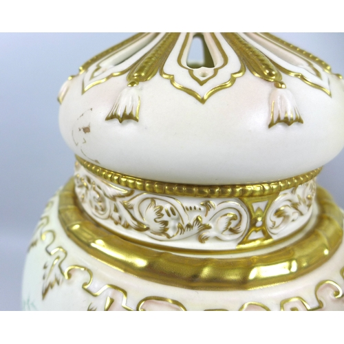69 - A pair of modern Royal Worcester blush ivory potpourri vases and pierced covers, decorated in 'Victo...