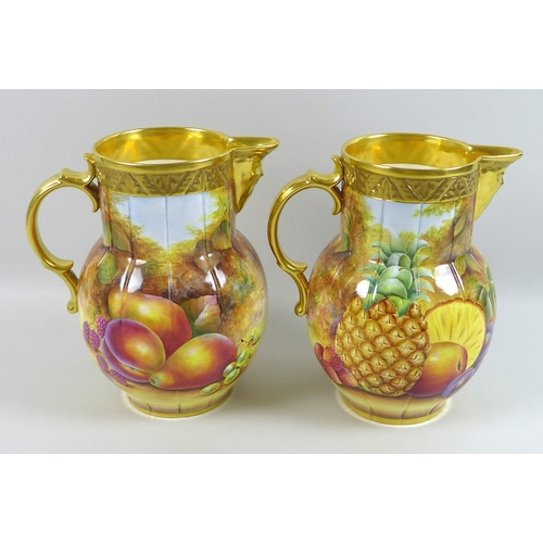 66 - A pair of modern Royal Worcester 'Pineapple Mask' jugs, decorated with peaches and pears, limited ed...