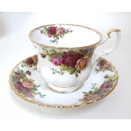 5 - A Royal Albert part dinner service in the Old Country Roses pattern, comprising teapot, vegetable tu...