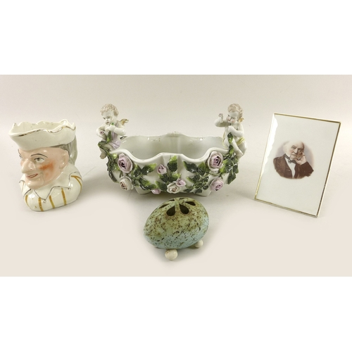 28 - A collection of 19th and 20th century ceramics including a 19th century oval bowl with applied putti...