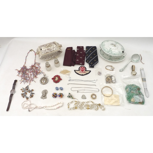38 - A collection of costume jewellery including an angel coral bead necklace, several silver brooches an...