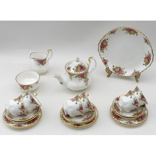 58 - A Royal Albert Old Country Roses part tea set, comprising teapot, milk jug, sugar bowl, cake plate, ...