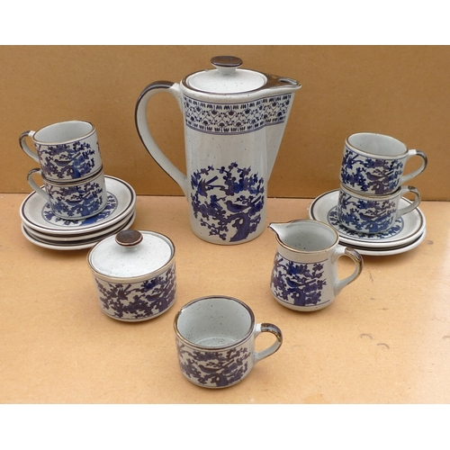 62 - A 1970's coffee set in the style of Denby, blue Oriental deSign of birds and sakura on grey ground, ...
