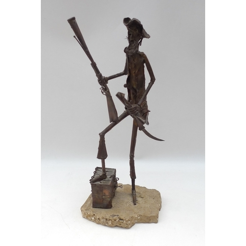 71 - A modern metal figure of a pirate, modelled standing with right foot raised on a barrel and holding ...