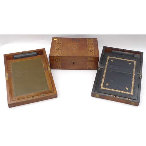 75 - A group of three Victorian wooden boxes, comprising a walnut writing slope with inlaid brass plaque,...