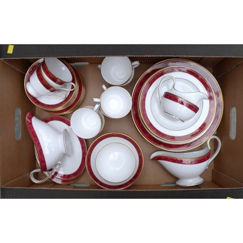 85 - A modern Spode eight person dinner service in Bordeaux pattern, including plates, cups saucers, bowl...