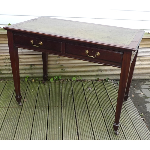 92 - An Edwardian two drawer desk, tooled leather top, square section tapering legs....