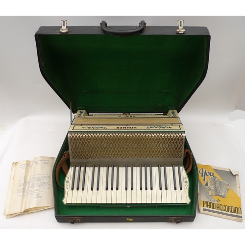 93 - A Hohner accordian complete with original carry case, together with a Smith Corona portable typewrit...