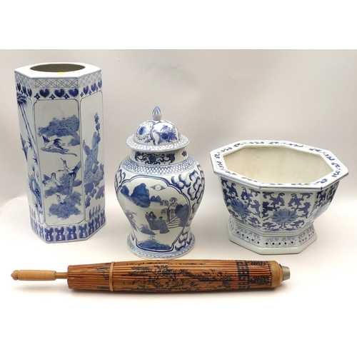 95 - A group of Chinese blue and white ceramics including an umbrella stand, a jardiniere, large ginger j...