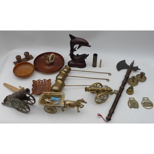 108 - A collection of metalware and treen  including two miniature brass cannon, horse brasses, a nut crac...