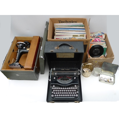 109 - A collection of items including a Singer sewing machine, a Smiths typewriter, a selection of vinyl r...
