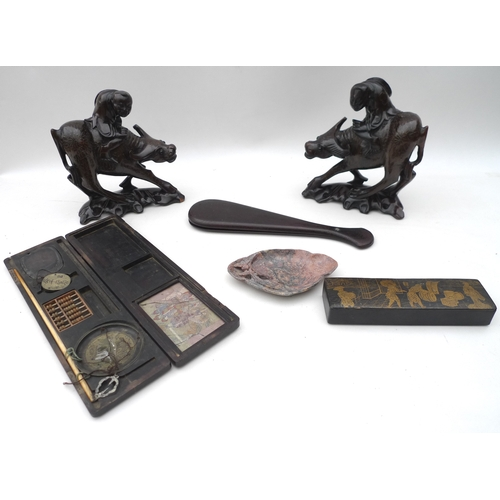 128 - A selection of items including a pair of 20th century carved oxen with boy's seated upon their backs...