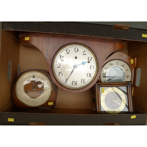 155 - A group of four mantel clocks, comprising a Smiths, a Napoleon hat, one in an oak frame, and one wit...