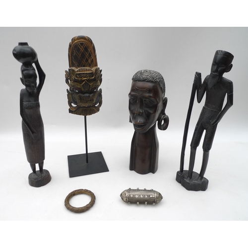 197 - A collection of African tribal art, including a large carved head of a lady, 31cm, a pair of carved ...