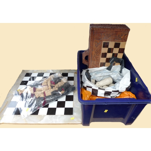 200 - A marble and onyx chess board with resin chess set together with a collection of ceramic and plastic...