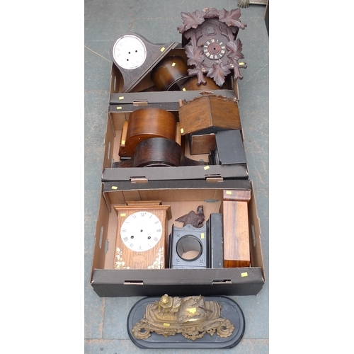 203 - A group of eleven mantel clock cases, all without movements, including a gilt metal figural case, on...