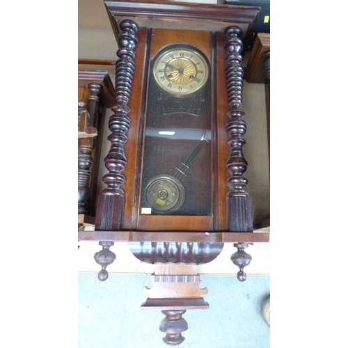 229 - A mahogany cased Vienna wall clock, horse surmount, brass embossed dial, twin train movement, with p...
