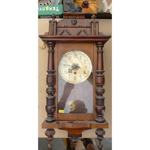 230 - A mahogany cased Vienna wall clock, horse surmount, cream dial with Arabic numerals, with pendulum, ...