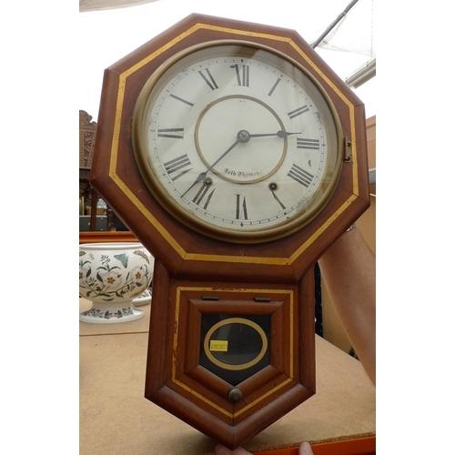 232 - An American Seth Thomas wall clock, with octagonal case and circular dial, 53cm high....