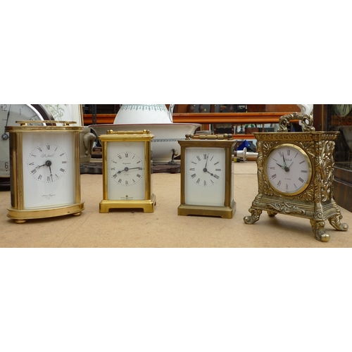 234 - A group of four carriage clocks, one with mount marked ACC, one with oval case marked St James, a Ba...