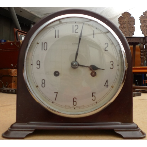 236 - A mid 20th century Enfield mantel clock in domed Bakelite case, with silvered dial and Arabic numera...