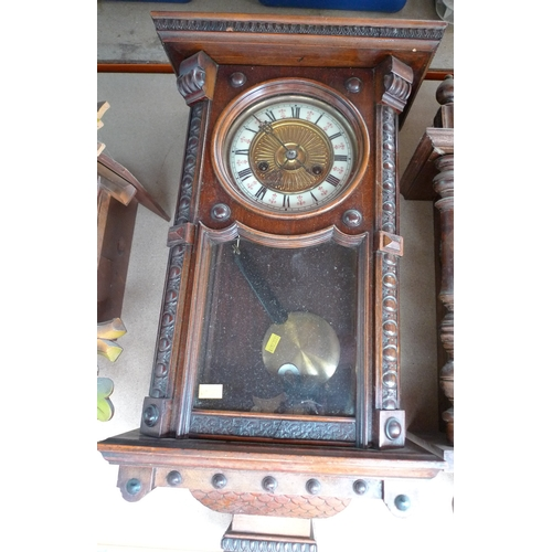 241 - A mahogany cased Vienna wall clock, pressed brass dial with cream chapter ring, with pendulum, 80cm....