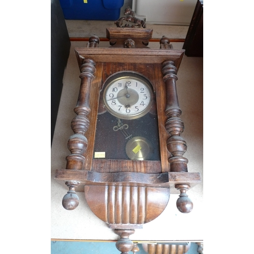 242 - A mahogany cased Vienna wall clock, horse surmount, with pendulum, 62cm....